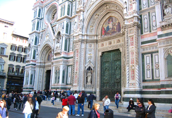 Panels of green, pink, and white marble decorate the Duomo